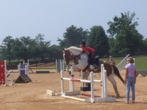 Shameful photo of me jumping Merry in a dressage saddle circa 2007